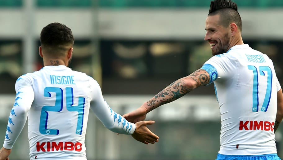 Napoli's Slovakian midfielder Marek Hamsik (R) and his teammate Italian midfielder Lorenzo Insigne (L) celebrate after scoring a goal during the Italian Serie A football match between Chievo and Napoli at the Bentegodi Stadium in Verona on February 19, 2017. / AFP / GIUSEPPE CACACE        (Photo credit should read GIUSEPPE CACACE/AFP/Getty Images)