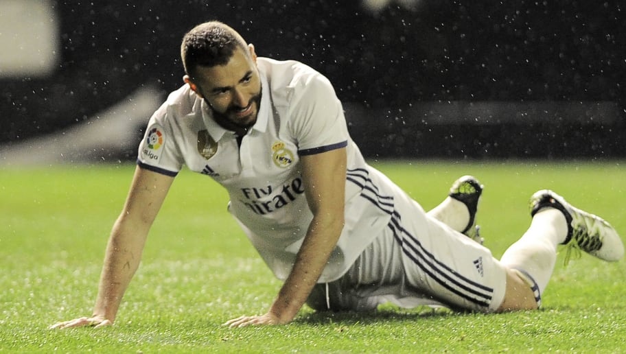 Real Madrid's French forward Karim Benzema lies on the ground during the Spanish league football match CA Osasuna vs Real Madrid CF at El Sadar stadium in Pamplona on February 11, 2017. / AFP / ANDER GILLENEA        (Photo credit should read ANDER GILLENEA/AFP/Getty Images)