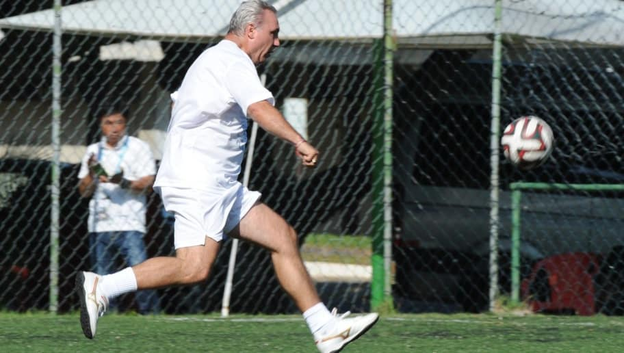 Former Bulgarian footballer Hristo Stoichkov kicks the ball during a charity football match organized by the Forever Foundation, in Barra da Tijuca, Rio de Janeiro, Brazil, on June 27, 2014. AFP PHOTO/TASSO MARCELO        (Photo credit should read TASSO MARCELO/AFP/Getty Images)