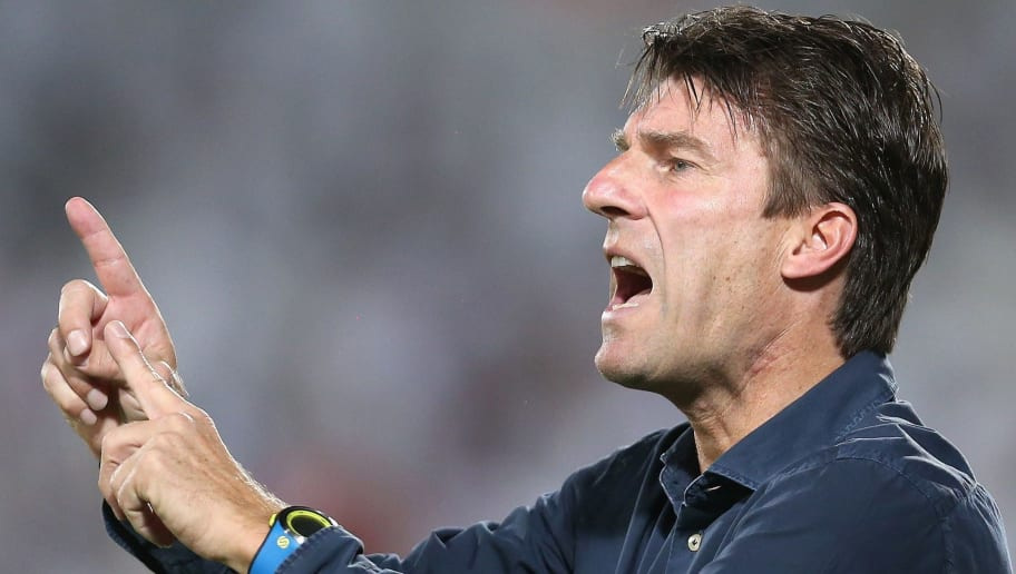 Qatar's Lekhwiya club head coach, Michael Laudrup of Denmark, gestures during their AFC Asian Champions League football match at the Abdulla bin Khalifa Stadium in Doha, on May 26, 2015. AFP PHOTO / AL-WATAN DOHA / KARIM JAAFAR  == QATAR OUT ==         (Photo credit should read KARIM JAAFAR/AFP/Getty Images)