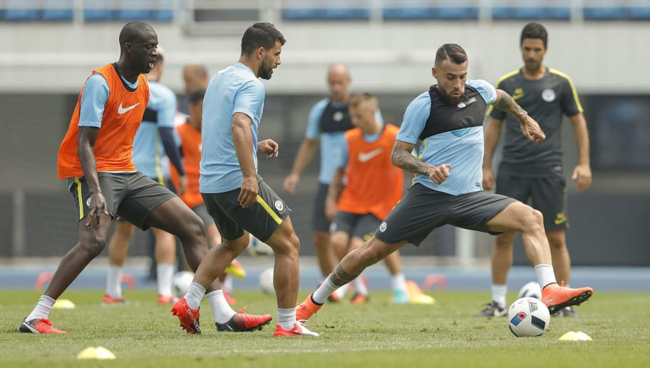 BEIJING, CHINA - JULY 24:  Sergio Aguero with Nicolas Otamendi of Manchester City in action during a training session of the 2016 International Champions Cup match between Manchester City and Manchester United at Olympic Sports Center Stadium on July 24, 2016 in Beijing, China.  (Photo by Lintao Zhang/Getty Images)