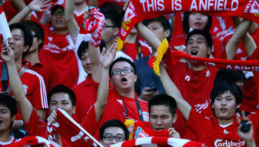 GUANGZHOU, CHINA - JULY 13:  Chinese fans of Liverpool sing the song before the pre-season friendly match between Guangdong Sunray Cave and Liverpool at Guangdong Provincial People's Stadium on July 13, 2011 in Guangzhou, China.  (Photo by Feng Li/Getty Images)