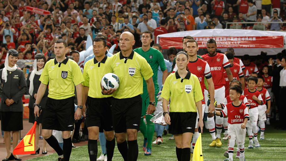 BEIJING, CHINA - JULY 27: Referee Howard Webb (C) leads the teams out to the pitch before the pre-season Asian Tour friendly match between Arsenal and Manchester City at Birds Nest Stadium on July 27, 2012 in Beijing, China.(Photo by Lintao Zhang/Getty Images)