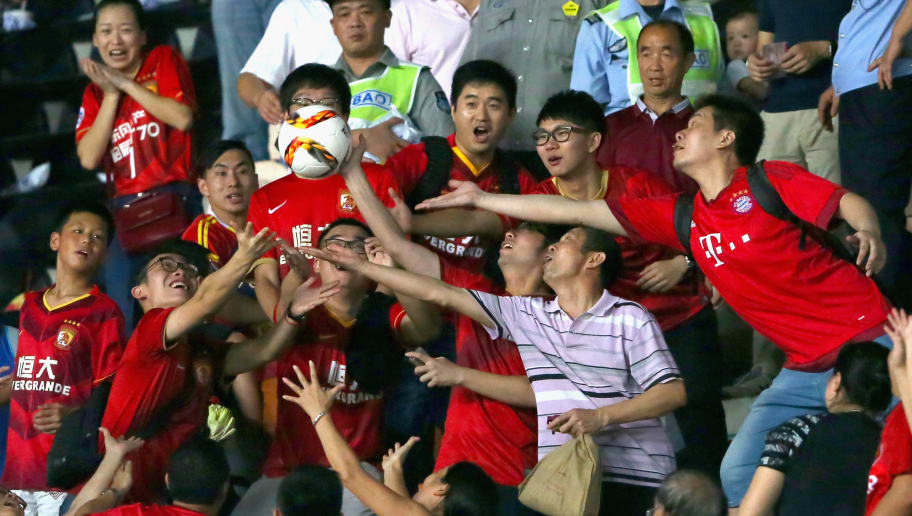 GUANGZHOU, CHINA - JULY 23:  Supporters catch the official matchball during the international friendly match between FC Guangzhou Evergrande Taobao FC and FC Bayern Muenchen of the Volkswagen Cup Guangzhou at Tianhe Stadium  on July 23, 2015 in Guangzhou, China.  (Photo by Alexander Hassenstein/Bongarts/Getty Images)