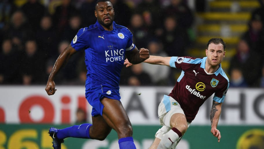 BURNLEY, ENGLAND - JANUARY 31: Ashley Barnes of Burnley and Wes Morgan of Leicester City compete for the ball  during the Premier League match between Burnley and Leicester City at Turf Moor on January 31, 2017 in Burnley, England.  (Photo by Gareth Copley/Getty Images)