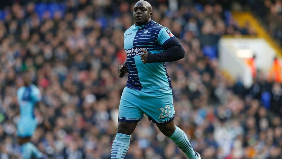 Wycombe Wanderers' English striker Adebayo Akinfenwa runs on the pitch during the English FA Cup fourth round football match between Tottenham Hotspur and Wycombe Wanderers at White Hart Lane in London, on January 28, 2017. / AFP / Ian KINGTON / RESTRICTED TO EDITORIAL USE. No use with unauthorized audio, video, data, fixture lists, club/league logos or 'live' services. Online in-match use limited to 75 images, no video emulation. No use in betting, games or single club/league/player publications.  /         (Photo credit should read IAN KINGTON/AFP/Getty Images)