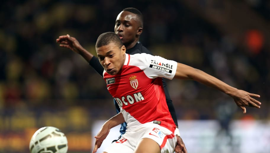 Monaco's French forward Kylian Mbappe Lottin (L) vies with Nancy's French defender Modou Diagne (R) during the French League Cup football match between Monaco (ASM) and  Nancy (ASNL) on January 25, 2017 at the Louis II stadium in Monaco. / AFP / VALERY HACHE        (Photo credit should read VALERY HACHE/AFP/Getty Images)