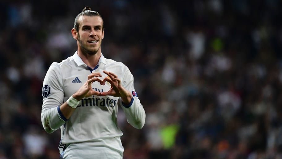 cb1599b592a Real Madrid s Welsh forward Gareth Bale celebrates after scoring during the  UEFA Champions League football match