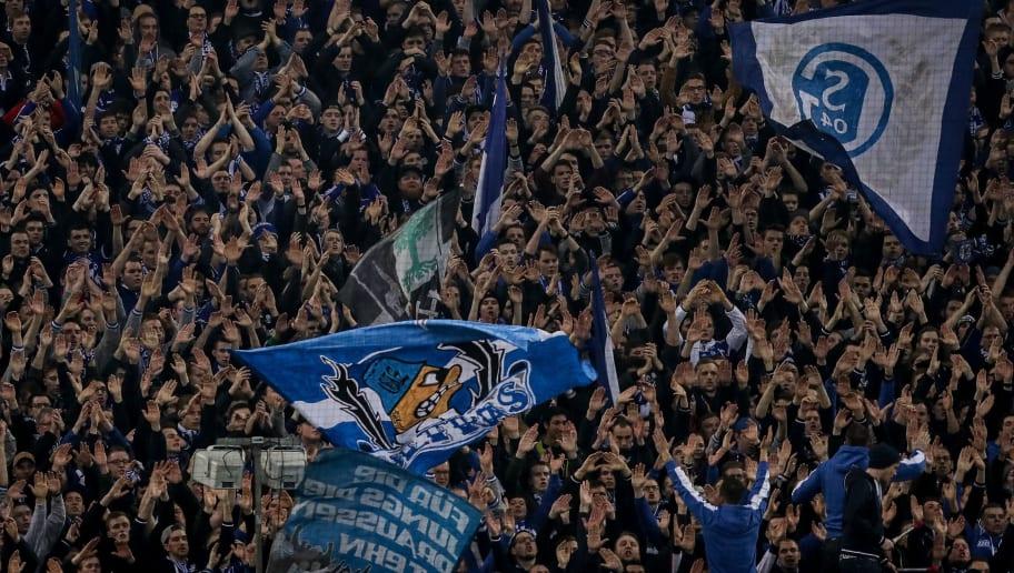 GELSENKIRCHEN, GERMANY - FEBRUARY 26: Fans of Schalke prior the Bundesliga match between FC Schalke 04 and TSG 1899 Hoffenheim at Veltins-Arena on February 26, 2017 in Gelsenkirchen, Germany. (Photo by Maja Hitij/Bongarts/Getty Images)