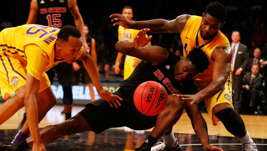 NEW YORK, NY - NOVEMBER 24:  Abdul-Malik Abu #0 of the North Carolina State Wolfpack fights for the ball against Brian Bridgewater #20 and Tim Quarterman #55 of the LSU Tigers at Barclays Center on November 24, 2015 in Brooklyn borough of New York City.  (Photo by Mike Stobe/Getty Images)