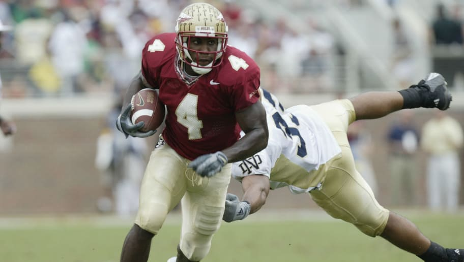 TALLAHASSEE, FL - OCTOBER 26:  FSU wide receiver Anquan Boldin #4 avoids the tackle by Notre Dame linebacker Courtney Watson #33 during the NCAA football game at Doak Campbell Stadium on October 26, 2002 in Tallahassee, Florida.  The Notre Dame Fighting Irish defeated the Florida State Seminoles 34-24.  (Photo by Craig Jones/Getty Images)