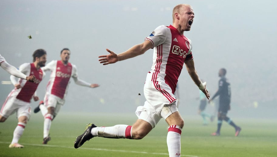 Ajax' Dutch midfielder Davy Klaassen (R) celebrates after scoring a goal during the Dutch League football match between AFC Ajax and PSV Eindhoven in Amsterdam, on December 18, 2016.  / AFP / ANP / Olaf KRAAK / Netherlands OUT        (Photo credit should read OLAF KRAAK/AFP/Getty Images)