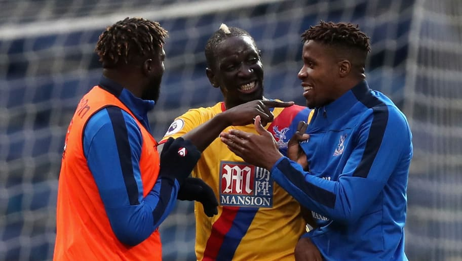 WEST BROMWICH, ENGLAND - MARCH 04: Bakary Sako of Crystal Palace (L), Mamadou Sakho of Crystal Palace (C) and Wilfried Zaha of Crystal Palace (R) celebrate after the game during the Premier League match between West Bromwich Albion and Crystal Palace at The Hawthorns on March 4, 2017 in West Bromwich, England.  (Photo by Christopher Lee/Getty Images)