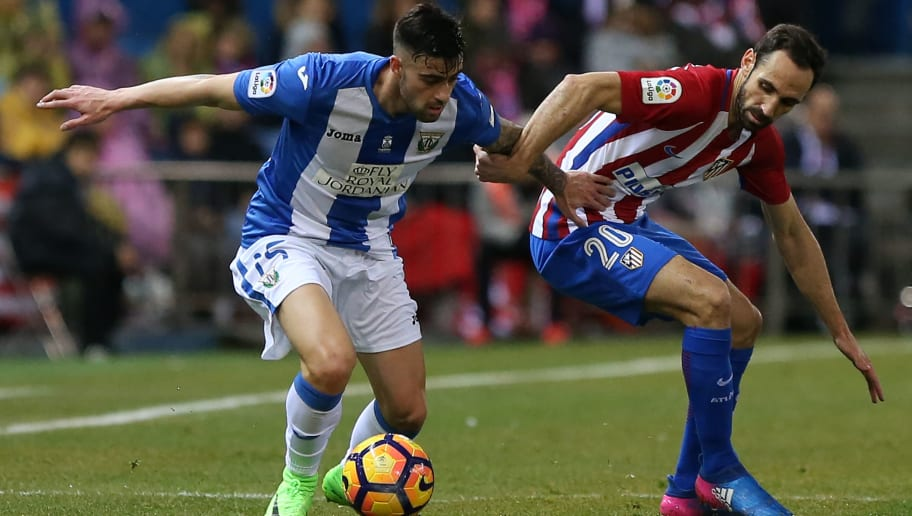 Leganes' midfielder Diego Rico (L) vies with Atletico Madrid's defender Juanfran during the Spanish league football match Club Atletico de Madrid vs Club Deportivo Leganes SAD at the Vicente Calderon stadium in Madrid on February 4, 2017. / AFP / CESAR MANSO        (Photo credit should read CESAR MANSO/AFP/Getty Images)