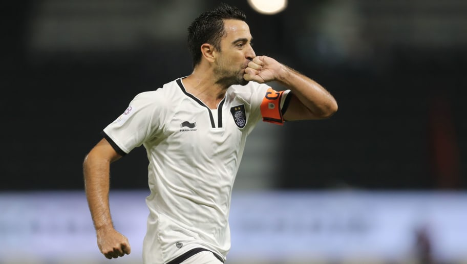 Qatari Al-Sadd club's Xavi Hernandez celebrates scoring a goal against Al-Rayyan's team during their Qatar Stars League football match at the Jassim Bin Hamad stadium in Doha on December 7, 2016. / AFP        (Photo credit should read /AFP/Getty Images)