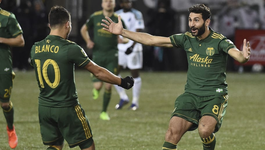 PORTLAND, OR - MARCH 03: Diego Valeri #8 celebrates with  Sebastian Blanco #10 of Portland Timbers after scoring a goal during the second half of the match against the Minnesota United at Providence Park on March 3, 2017 in Portland, Oregon. The Timbers won 5-1.  (Photo by Steve Dykes/Getty Images)