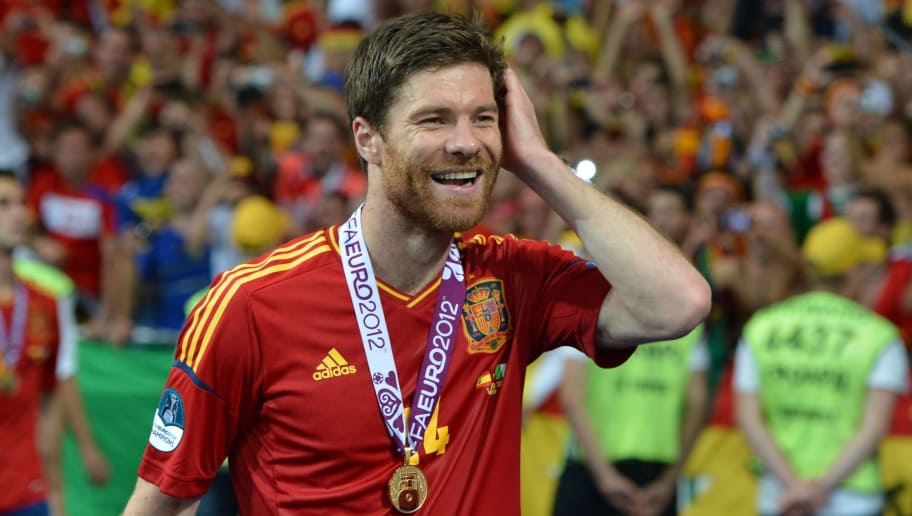 Spanish midfielder Xabi Alonso smiles after winning the Euro 2012 football championships final match Spain vs Italy on July 1, 2012 at the Olympic Stadium in Kiev. AFP PHOTO / GABRIEL BOUYS        (Photo credit should read GABRIEL BOUYS/AFP/GettyImages)