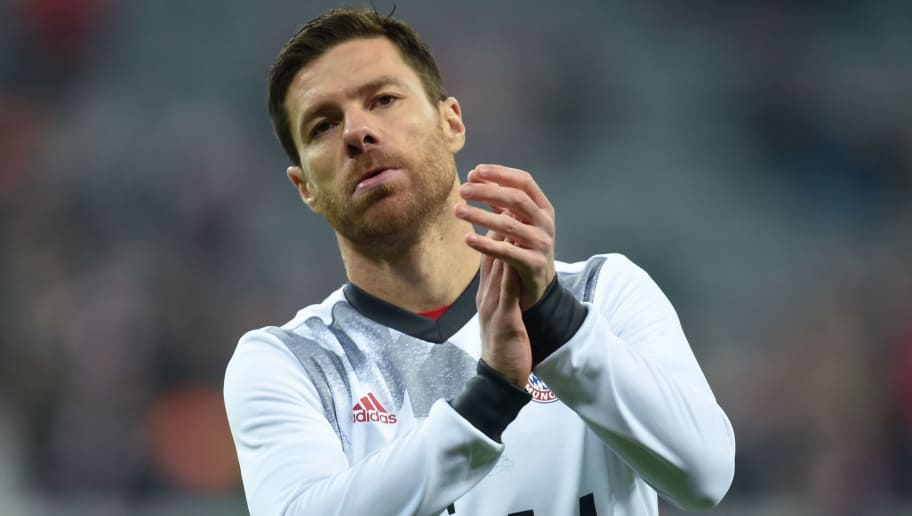 Bayern Munich's Spanish midfielder Xabi Alonso applauds as he arrives in the stadium ahead the German Cup DFB Pokal Round of 16 football match FC Bayern Munich v VFL Wolfburg in Munich, southern Germany on February 7, 2017. / AFP / Christof STACHE / RESTRICTIONS: ACCORDING TO DFB RULES IMAGE SEQUENCES TO SIMULATE VIDEO IS NOT ALLOWED DURING MATCH TIME. MOBILE (MMS) USE IS NOT ALLOWED DURING AND FOR FURTHER TWO HOURS AFTER THE MATCH. == RESTRICTED TO EDITORIAL USE == FOR MORE INFORMATION CONTACT DFB DIRECTLY AT +49 69 67880   /         (Photo credit should read CHRISTOF STACHE/AFP/Getty Images)
