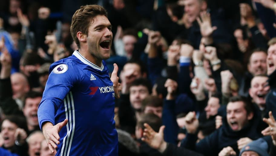 Chelsea's Spanish defender Marcos Alonso celebrates scoring the opening goal during the English Premier League football match between Chelsea and Arsenal at Stamford Bridge in London on February 4, 2017. / AFP / Ian KINGTON / RESTRICTED TO EDITORIAL USE. No use with unauthorized audio, video, data, fixture lists, club/league logos or 'live' services. Online in-match use limited to 75 images, no video emulation. No use in betting, games or single club/league/player publications.  /         (Photo credit should read IAN KINGTON/AFP/Getty Images)