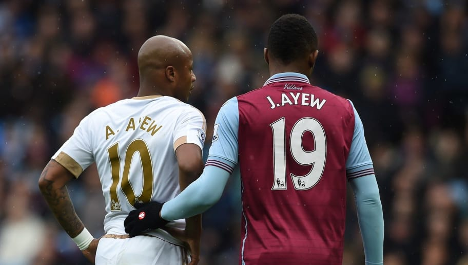 Aston Villa's Ghanaian striker Jordan Ayew (R) marks his brother Swansea City's Ghanaian striker Andre Ayew (L) at a corner during the English Premier League football match between Aston Villa and Swansea City at Villa Park in Birmingham, central England on October 24, 2015. AFP PHOTO / PAUL ELLIS  RESTRICTED TO EDITORIAL USE. No use with unauthorized audio, video, data, fixture lists, club/league logos or 'live' services. Online in-match use limited to 75 images, no video emulation. No use in betting, games or single club/league/player publications.        (Photo credit should read PAUL ELLIS/AFP/Getty Images)