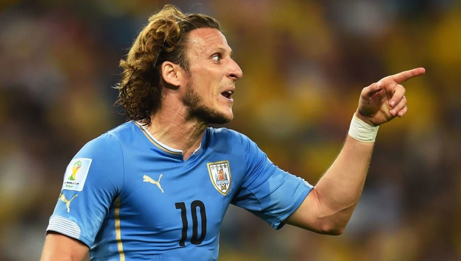 RIO DE JANEIRO, BRAZIL - JUNE 28:  Diego Forlan of Uruguay reacts during the 2014 FIFA World Cup Brazil round of 16 match between Colombia and Uruguay at Maracana on June 28, 2014 in Rio de Janeiro, Brazil.  (Photo by Matthias Hangst/Getty Images)