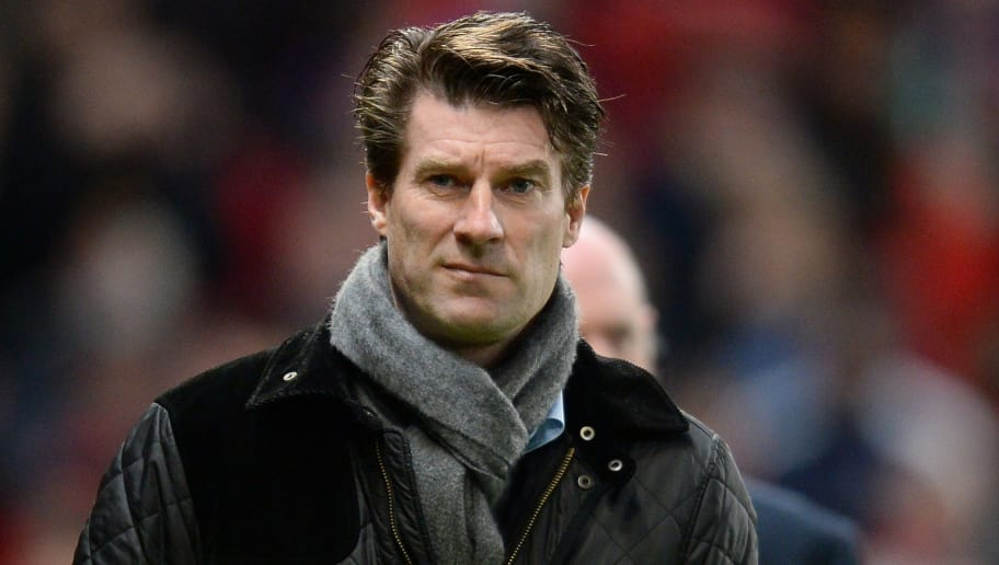 Swansea City's Danish manager Michael Laudrup looks on during the English FA Cup third round football match between Manchester United and Swansea City at Old Trafford in Manchester, northwest England, on January 5, 2014. AFP PHOTO / ANDREW YATES   RESTRICTED TO EDITORIAL USE. No use with unauthorized audio, video, data, fixture lists, club/league logos or live services. Online in-match use limited to 45 images, no video emulation. No use in betting, games or single club/league/player publications        (Photo credit should read ANDREW YATES/AFP/Getty Images)