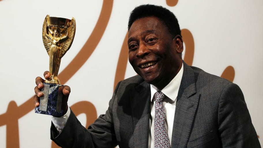 Former Brazilian footballer Pele holds a replica Jules Rimet trophy, a trophy awarded to the winner of the football World Cup, during an media interview at a preview for an auction of his memorabilia in London on June 1, 2016.   The three-time World Cup winner and FIFA Player of the Century is offering to auction his vast memorabilia collection including awards, personal property and iconic items from his entire career. The collection is being offered by Julien's Auction House on June 7, 8, 9 in London. / AFP / ADRIAN DENNIS        (Photo credit should read ADRIAN DENNIS/AFP/Getty Images)