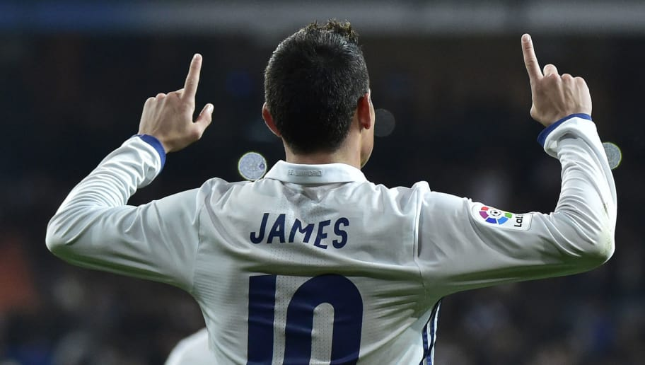TOPSHOT - Real Madrid's Colombian midfielder James Rodriguez celebrates after scoring on a penalty kick during the Spanish Copa del Rey (King's Cup) round of 16 first leg football match Real Madrid CF vs Sevilla FC at the Santiago Bernabeu stadium in Madrid on January 4, 2017. / AFP / GERARD JULIEN        (Photo credit should read GERARD JULIEN/AFP/Getty Images)