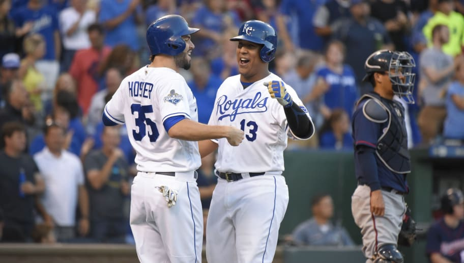 KANSAS CITY, MO - AUGUST 20: Salvador Perez #13 of the Kansas City Royals celebrates with Eric Hosmer #35 hitting a home run against the Minnesota Twins at Kauffman Stadium on August 20, 2016 in Kansas City, Missouri. (Photo by Ed Zurga/Getty Images)