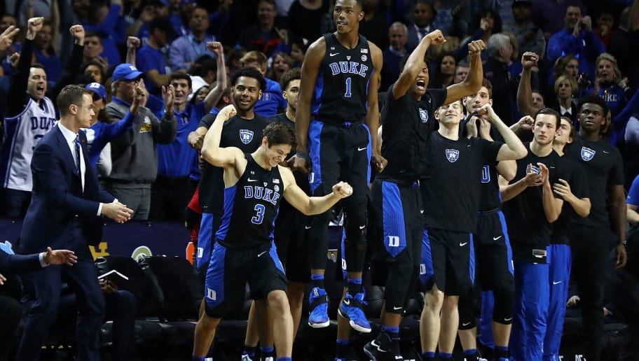 NEW YORK, NY - MARCH 11:  The Duke Blue Devils bench reacts in the final seconds of their 75-69 win over the Notre Dame Fighting Irish during the championship game of the 2017 Men's ACC Basketball Tournament at the Barclays Center on March 11, 2017 in New York City.  (Photo by Al Bello/Getty Images)