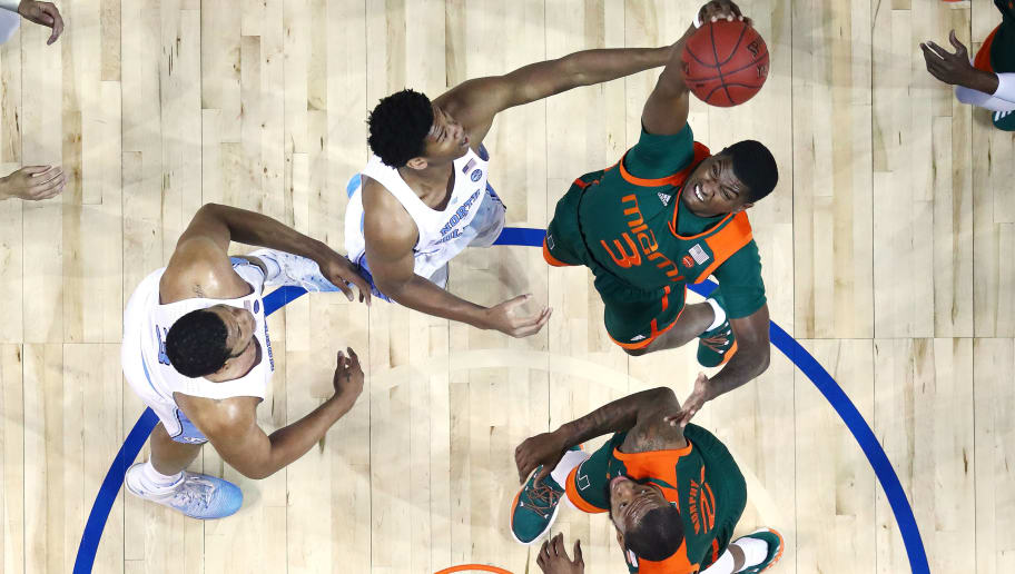 NEW YORK, NY - MARCH 09:  Anthony Lawrence Jr. #3 of the Miami (Fl) Hurricanes and Isaiah Hicks #4 of the North Carolina Tar Heels battle for the ball during the Quarterfinals of the ACC Basketball Tournament  at the Barclays Center on March 9, 2017 in New York City.  (Photo by Al Bello/Getty Images)