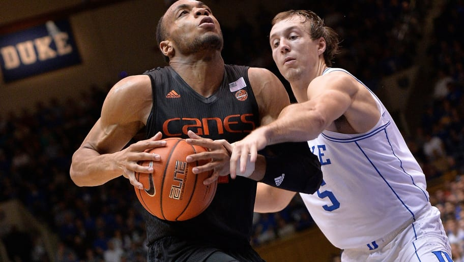 DURHAM, NC - JANUARY 21:  Luke Kennard #5 of the Duke Blue Devils fouls Bruce Brown #11 of the Miami Hurricanes during the game at Cameron Indoor Stadium on January 21, 2017 in Durham, North Carolina. Duke won 70-58.  (Photo by Grant Halverson/Getty Images)