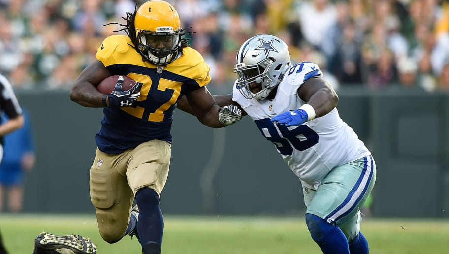 GREEN BAY, WI - OCTOBER 16:  Eddie Lacy #27 of the Green Bay Packers looks to avoid the tackle attempt from Maliek Collins #96 of the Dallas Cowboys during the second quarter at Lambeau Field on October 16, 2016 in Green Bay, Wisconsin.  (Photo by Hannah Foslien/Getty Images)