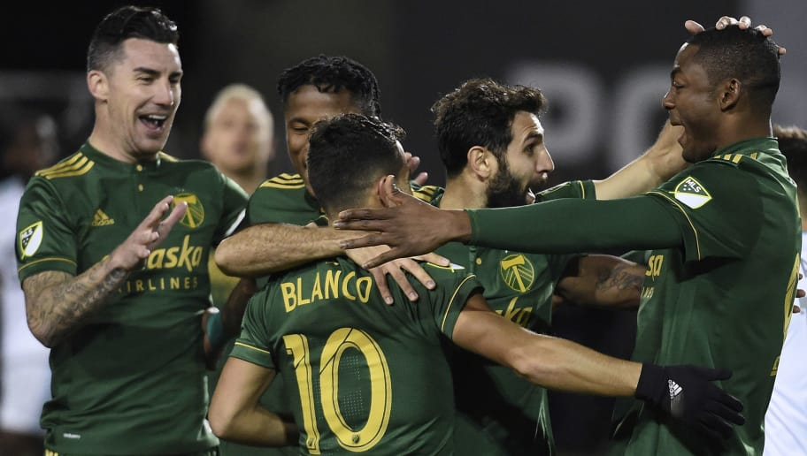PORTLAND, OR - MARCH 03; Liam Ridgewell #24, Sebastian Blanco #10, Diego Valeri #8 and Fanendo Adi #9 celebrate after Valeri scored a goal during the second half of the match against the Minnesota United at Providence Park on March 3, 2017 in Portland, Oregon. (Photo by Steve Dykes/Getty Images)