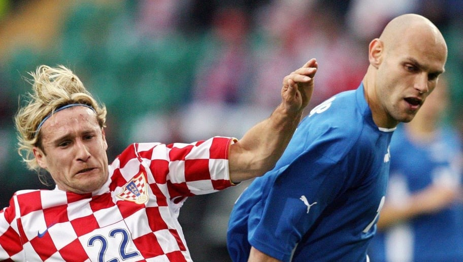 WOLFSBURG, GERMANY - JUNE 3: Ivan Bosnjak (L) of Croatia challenges with Mariuz Jop of Poland during the international friendly match between Poland and Croatia at the Volkswagen Arena on June 3, 2006 in Wolfsburg, Germany. (Photo by Ronny Hartmann/Bongarts/Getty Images)