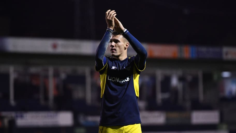 LUTON, ENGLAND - MARCH 01:  Marvin Johnson of Oxford United applauds the fans following his side's victory during the EFL Checkatrade Trophy Semi Final match between Luton Town and Oxford United at Kenilworth Road on March 1, 2017 in Luton, England. (Photo by Dan Mullan/Getty Images)