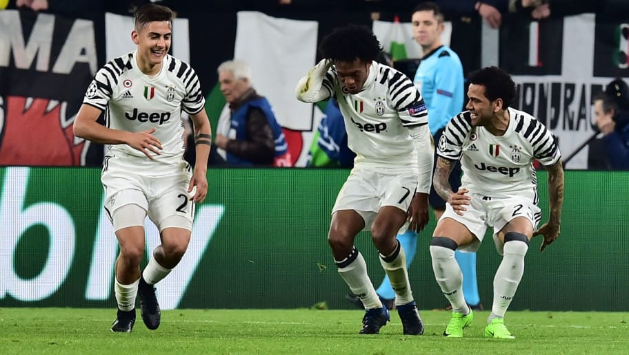 Juventus' forward from Argentina Paulo Dybala celebrates with teammates Juventus' forward from Colombia Juan Cuadrado (C) and Juventus Defender from Brazil Dani Alves after scoring a penalty during the UEFA Champions League football match Juventus vs FC Porto on March 14, 2017 at the Juventus stadium in Turin. / AFP PHOTO / GIUSEPPE CACACE        (Photo credit should read GIUSEPPE CACACE/AFP/Getty Images)