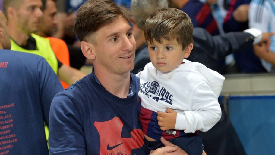 Barcelona's Argentinian forward Lionel Messi carries his son Thiago after the UEFA Champions League Final football match between Juventus and FC Barcelona at the Olympic Stadium in Berlin on June 6, 2015. FC Barcelona won the match 1-3.        AFP PHOTO / OLIVER LANG        (Photo credit should read OLIVER LANG/AFP/Getty Images)