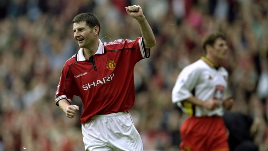 16 Oct 1999:  Dennis Irwin celebrates a goal from the Penalty spot during the FA Carling Premiership game against Watford at Old Trafford in Manchester, England. United won 4 - 1. \ Mandatory Credit: Clive Brunskill /Allsport