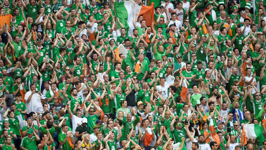 Ireland's supporters cheer ahead the Euro 2016 round of 16 football match between France and Republic of Ireland at the Parc Olympique Lyonnais stadium in Décines-Charpieu, near Lyon, on June 26, 2016.    / AFP / PHILIPPE DESMAZES        (Photo credit should read PHILIPPE DESMAZES/AFP/Getty Images)