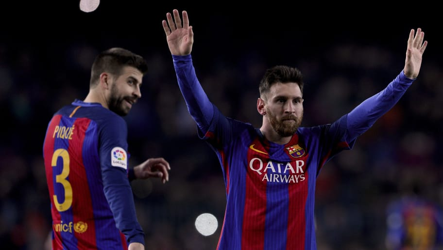 Barcelona's Argentinian forward Lionel Messi (R) celebrates his goal beside Barcelona's defender Gerard Pique during the Spanish league football match FC Barcelona vs RCD Espanyol at the Camp Nou stadium in Barcelona on December 18, 2016. / AFP / JOSEP LAGO        (Photo credit should read JOSEP LAGO/AFP/Getty Images)