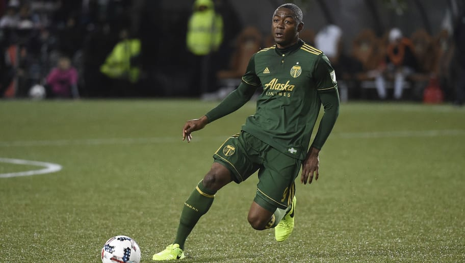 PORTLAND, OR - MARCH 03: Fanendo Adi #9 of the Portland Timbers brings tge ball up the pitch during the second half of the match against the Minnesota United at Providence Park on March 3, 2017 in Portland, Oregon. The penalty resulted in a penalty kick as the Timbers won 5-1.  (Photo by Steve Dykes/Getty Images)