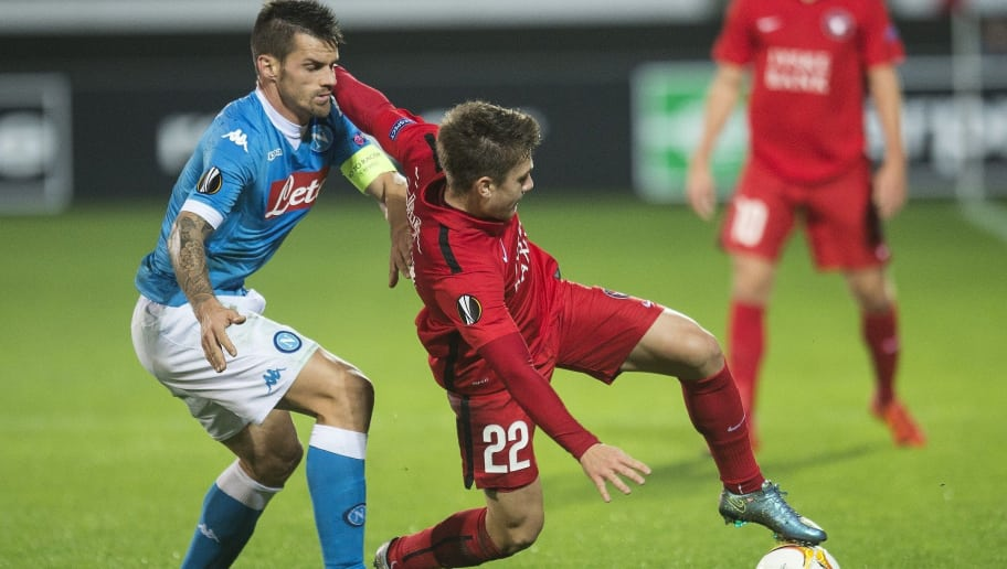 Mikkel Duelund of FC Midtjylland (R) in action against Christian Maggio of Napoli during the UEFA Europa Leage football match FC Midtjylland v SSC Napoli in Herning on October 22, 2015. AFP PHOTO / SCANPIX DENMARK / CLAUS FISKER  +++ DENAMRK OUT+++        (Photo credit should read CLAUS FISKER/AFP/Getty Images)