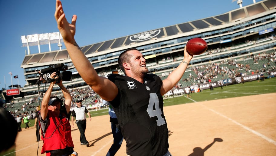 OAKLAND, CA - SEPTEMBER 20:  Derek Carr #4 of the Oakland Raiders celebrates a win over the Baltimore Ravens at Oakland-Alameda County Coliseum on September 20, 2015 in Oakland, California.  (Photo by Ezra Shaw/Getty Images)