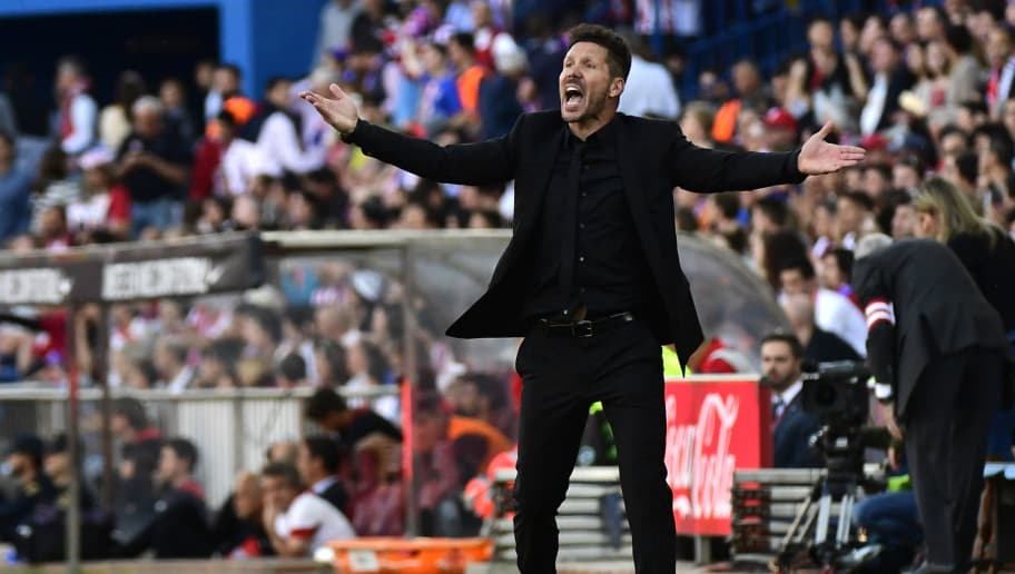 Atletico Madrid's Argentinian coach Diego Simeone gestures during the Spanish league football match Club Atletico de Madrid vs Sevilla FC at the Vicente Calderon stadium in Madrid on March 19, 2017. / AFP PHOTO / PIERRE-PHILIPPE MARCOU        (Photo credit should read PIERRE-PHILIPPE MARCOU/AFP/Getty Images)