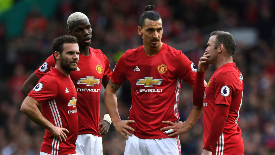 MANCHESTER, ENGLAND - MARCH 04:  Juan Mata of Manchester United (L), Paul Pogba of Manchester United (C), Zlatan Ibrahimovic of Manchester United (CR) and Wayne Rooney of Manchester United (R) all look on as they decied who will take a freekick during the Premier League match between Manchester United and AFC Bournemouth at Old Trafford on March 4, 2017 in Manchester, England.  (Photo by Shaun Botterill/Getty Images)