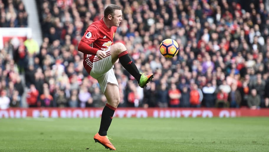 Manchester United's English striker Wayne Rooney controls the ball during the English Premier League football match between Manchester United and Bournemouth at Old Trafford in Manchester, north west England, on March 4, 2017. / AFP PHOTO / Oli SCARFF / RESTRICTED TO EDITORIAL USE. No use with unauthorized audio, video, data, fixture lists, club/league logos or 'live' services. Online in-match use limited to 75 images, no video emulation. No use in betting, games or single club/league/player publications.  /         (Photo credit should read OLI SCARFF/AFP/Getty Images)
