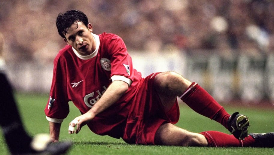 7 Nov 1998:  Robbie Fowler of Liverpool is challenged and left on the ground by the Derby County defence during the FA Carling Premiership match against Derby County played at Anfield in Liverpool, England.  The match finished in a 1-2 victory for the visitors Derby County. \ Mandatory Credit: Mark Thompson /Allsport