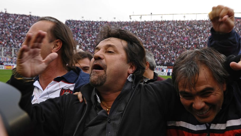 San Lorenzo's team coach Ricardo Caruso Lombardi (C) celebrates after his team tied 1-1 against Instituto during the Argentina's Promotion football match, at the Nuevo Gasometro stadium in Buenos Aires, on July 1, 2012.  San Lorenzo remains in the first division of Argentina's football.  AFP PHOTO/Alejandro PAGNI        (Photo credit should read ALEJANDRO PAGNI/AFP/GettyImages)