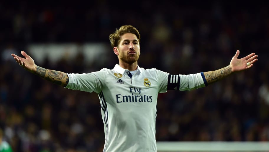 Real Madrid's defender Sergio Ramos celebrates after scoring a goal during the Spanish league footbal match Real Madrid CF vs Real Betis at the Santiago Bernabeu stadium in Madrid on March 12, 2017. / AFP PHOTO / GERARD JULIEN        (Photo credit should read GERARD JULIEN/AFP/Getty Images)